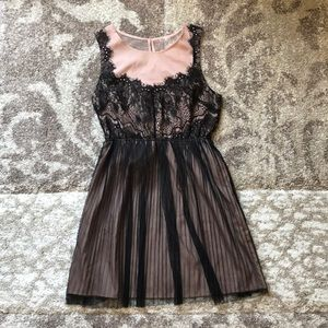 Beige pink and black lace dress.